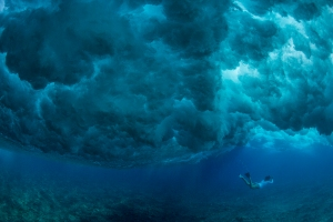 Diving under a huge wave at Makaha, on Oahu. Photo by Paul Nicklen