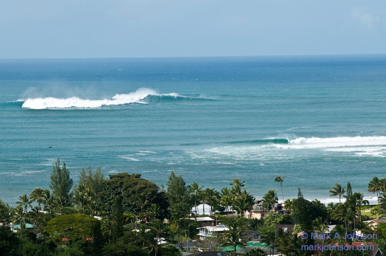 Surf lineup at Hanalei Bay, Kauai, Hawaii. Outer reef called King's breaking
