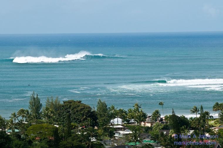 Surf lineup at Hanalei Bay, Kauai, Hawaii. Outer reef called King's breaking