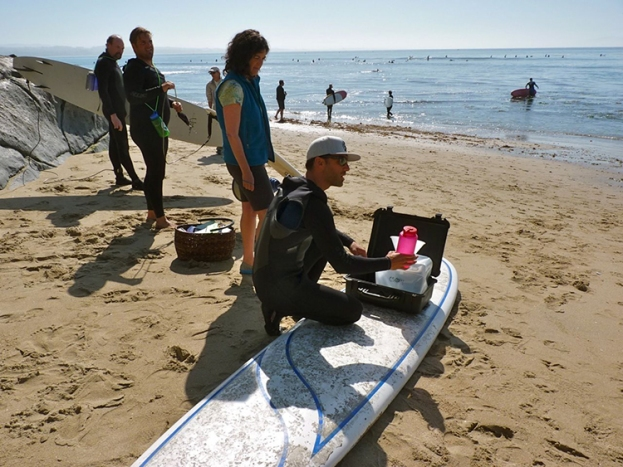 Coastal communities from Alaska to southern California have helped WHOI marine chemist Ken Buesseler to monitor marine radioactivity levels. In the image above, surfers gather a water sample at Pleasure Point in Santa Cruz, California. (Courtesy of Robin Brune)